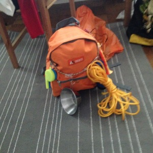 Backpack with everything a Wilderness Explorer needs including Trumpet, Rope, Camping Bowl, Whistle and Flashlight.